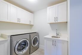 bigstock-An-empty-laundry-room-with-cab-171689690.jpg