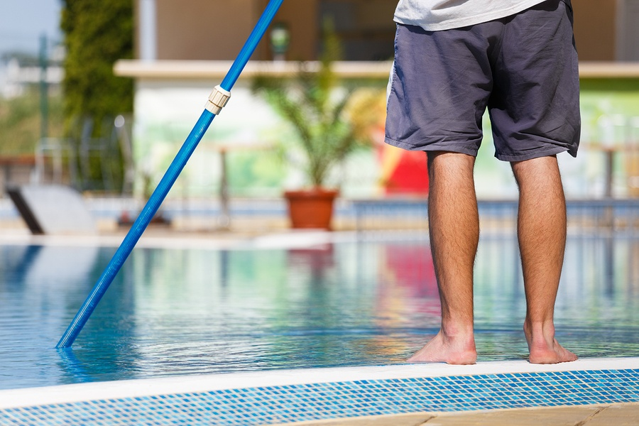bigstock-Man-Cleaning-The-Swimming-Pool-120402833.jpg
