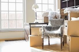 bigstock-Moving-boxes-and-furniture-in--169360670.jpg