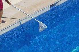 bigstock-Swimming-Pool-Cleaner-147644039.jpg