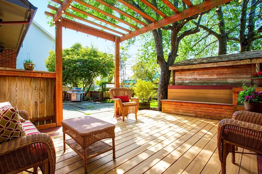 bigstock-Backyard-Deck-With-Wicker-Furn-143105315.jpg