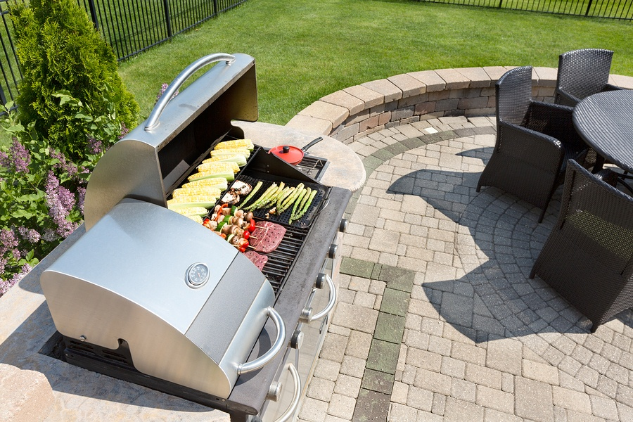 bigstock-Grilling-Food-On-An-Outdoor-Ga-91566653.jpg