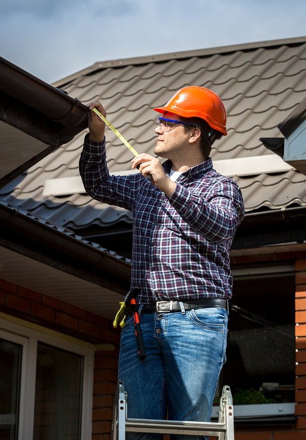 bigstock-Handyman-Standing-On-High-Ladd-89339417.jpg
