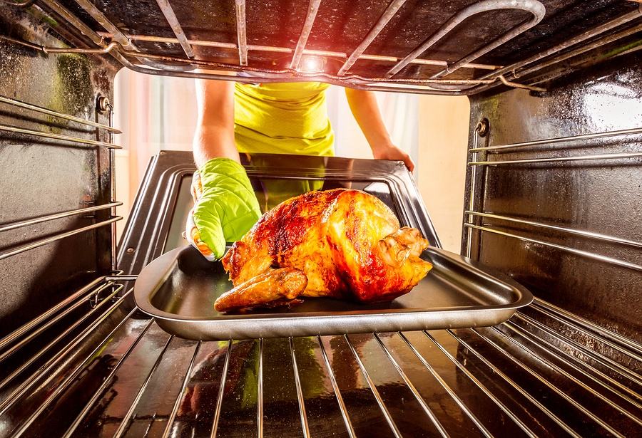 bigstock-Housewife-prepares-roast-chick-257840080