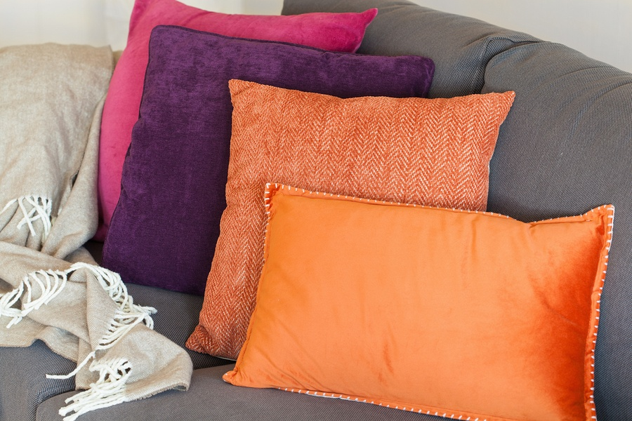bigstock-colorful-cushion-on-sofa-cozy--154212614.jpg