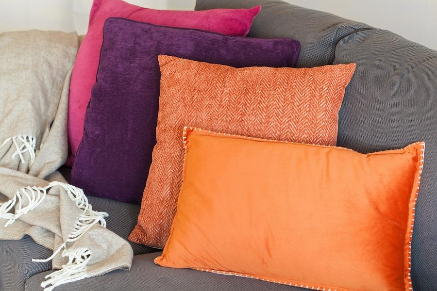 bigstock-colorful-cushion-on-sofa-cozy--154212614.jpg